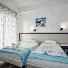 Отель Gorgona 3* Стандартный номер с 2 отдельными кроватями фото 13