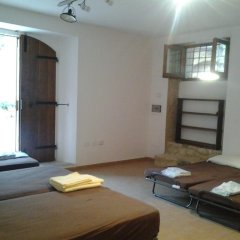 Отель A Casa di Francesco Кровать в общем номере фото 5