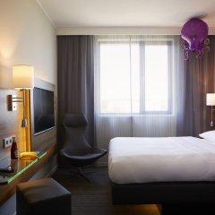Отель Moxy London Excel Стандартный номер с различными типами кроватей фото 4