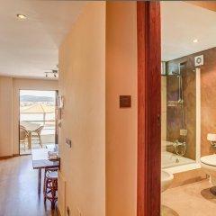Отель Astuy Apartamentos Арнуэро ванная фото 2