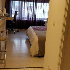 Отель The Ashtan Sarovar Portico Индия, Нью-Дели - отзывы, цены и фото номеров - забронировать отель The Ashtan Sarovar Portico онлайн удобства в номере фото 2
