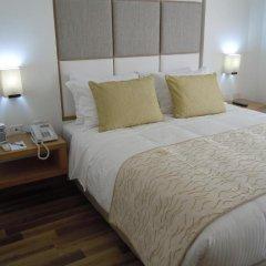 Отель Cosmos Cali 3* Улучшенный номер с различными типами кроватей