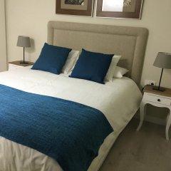 Отель Colon Suites комната для гостей
