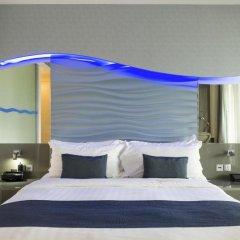 Отель ONE°15 Marina Club Singapore 4* Стандартный семейный номер с различными типами кроватей фото 3