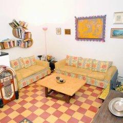 Апартаменты Apartment Casa bella di charme комната для гостей