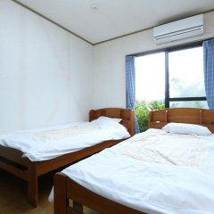 Отель Minshuku Shiratani Якусима комната для гостей