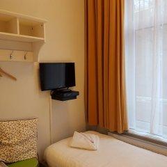 Отель Freeland Нидерланды, Амстердам - отзывы, цены и фото номеров - забронировать отель Freeland онлайн удобства в номере фото 2