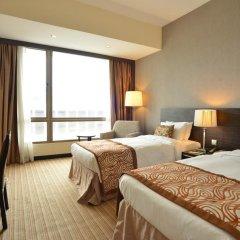 Peninsula Excelsior Hotel 4* Стандартный номер с различными типами кроватей фото 3