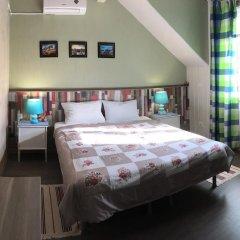 Гостиница Berloga-City Mini-Hotel в Великом Новгороде отзывы, цены и фото номеров - забронировать гостиницу Berloga-City Mini-Hotel онлайн Великий Новгород комната для гостей фото 5