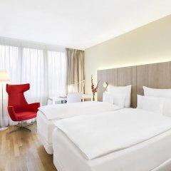 Отель NH Collection Hamburg City 4* Улучшенный номер с различными типами кроватей фото 3