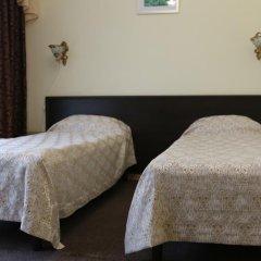 Гостиница Кавказ Стандартный семейный номер разные типы кроватей фото 13