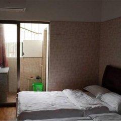 Отель Huanxi Inn комната для гостей