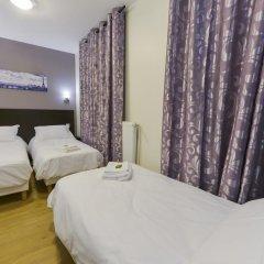 Отель Hôtel du Quai de Seine 2* Стандартный номер с различными типами кроватей фото 10