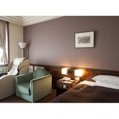 Отель Clio Court Hakata 3* Кровать в женском общем номере фото 4