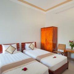 Отель Tra Que Flower Homestay Стандартный номер с двуспальной кроватью фото 9