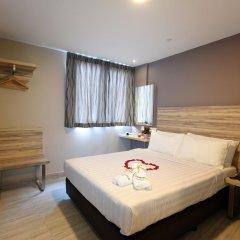 Отель Ibis Budget Singapore Crystal 2* Улучшенный номер с различными типами кроватей фото 8