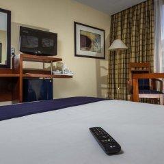 Отель Holiday Inn Lisbon 4* Стандартный номер с разными типами кроватей фото 2