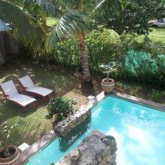Отель Residence Les Cocotiers Французская Полинезия, Папеэте - отзывы, цены и фото номеров - забронировать отель Residence Les Cocotiers онлайн бассейн фото 3