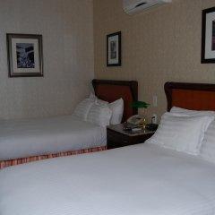 Windsor Inn Hotel 2* Стандартный номер с 2 отдельными кроватями фото 2