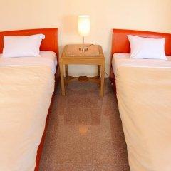 Отель Cottage Seaside Центр Окинавы комната для гостей фото 4