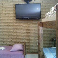 Гостиница Марсель Улучшенный семейный номер с разными типами кроватей фото 6