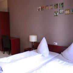 Отель Plus Berlin Стандартный семейный номер с различными типами кроватей фото 3