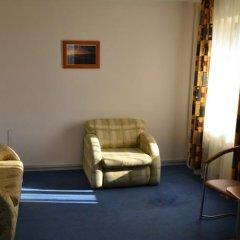 Апартаменты NRC Apartments Сочи комната для гостей