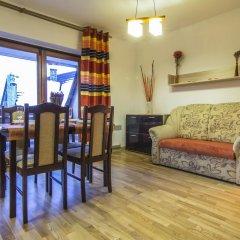 Отель Apartamenty Snowbird Zakopane Косцелиско комната для гостей фото 5