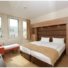 Отель Motel Plus Berlin 3* Стандартный семейный номер с различными типами кроватей фото 8