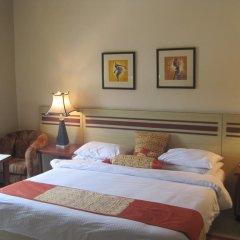 Axari Hotel & Suites комната для гостей