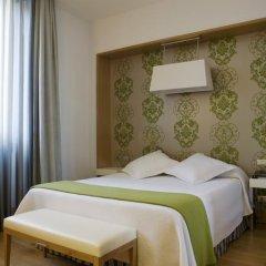 Отель NH Milano Touring 4* Стандартный номер разные типы кроватей фото 4