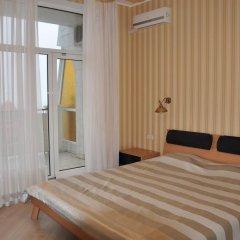 Апартаменты Arcadia Palace Апартаменты с видом на море комната для гостей фото 4