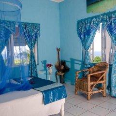 Отель Ackee Tree Sea View Villa Ямайка, Порт Антонио - отзывы, цены и фото номеров - забронировать отель Ackee Tree Sea View Villa онлайн комната для гостей фото 3
