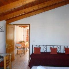 Апартаменты Pettas Apartments комната для гостей фото 2