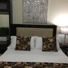 Отель MCH Suites at Le Mirage de Malate Филиппины, Манила - отзывы, цены и фото номеров - забронировать отель MCH Suites at Le Mirage de Malate онлайн комната для гостей фото 4