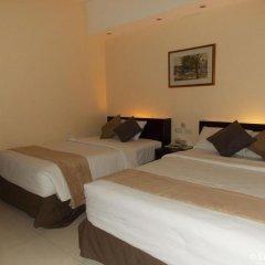 Отель M Citi Suites 3* Номер Делюкс с различными типами кроватей фото 6