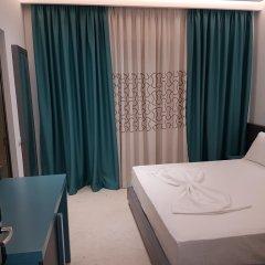 Отель Delfini Албания, Саранда - отзывы, цены и фото номеров - забронировать отель Delfini онлайн комната для гостей фото 4