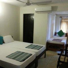 Отель Thiranagama Beach Hotel Шри-Ланка, Хиккадува - отзывы, цены и фото номеров - забронировать отель Thiranagama Beach Hotel онлайн комната для гостей