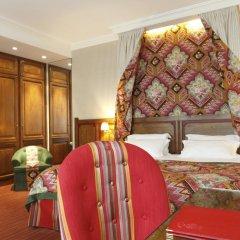 Отель Hôtel Au Manoir St-Germain des Prés 4* Улучшенный номер с различными типами кроватей фото 4