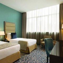 Отель Ramada Corniche 4* Номер Делюкс фото 3