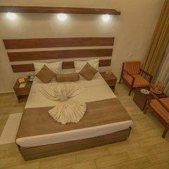 Отель Avenra Beach Hikkaduwa 4* Номер Делюкс с различными типами кроватей фото 6