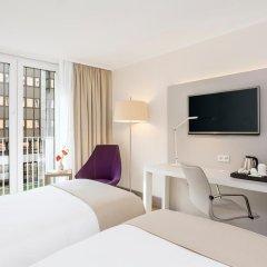 Отель NH Collection Berlin Mitte Am Checkpoint Charlie 4* Улучшенный номер с разными типами кроватей фото 20