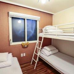 Отель Aroha Guest House 2* Кровать в общем номере с двухъярусной кроватью фото 5