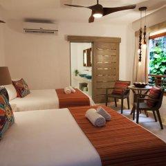 Отель Mahekal Beach Resort комната для гостей
