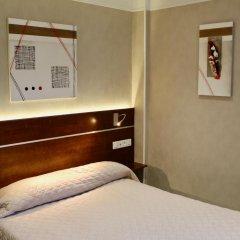 Hotel Des Pyrenees Париж сейф в номере