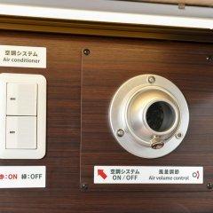 Отель Anshin Oyado Premier Shinbashi Shiodome 2* Капсула в мужском общем номере фото 9