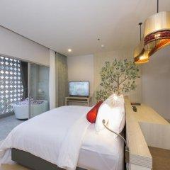 Отель Ramada by Wyndham Phuket Deevana Patong Номер Делюкс с двуспальной кроватью фото 4