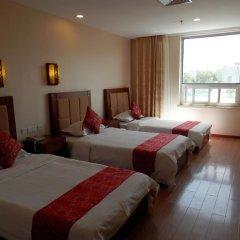 Отель Chinese Culture Holiday Hotel - Nanluoguxiang Китай, Пекин - отзывы, цены и фото номеров - забронировать отель Chinese Culture Holiday Hotel - Nanluoguxiang онлайн комната для гостей фото 5