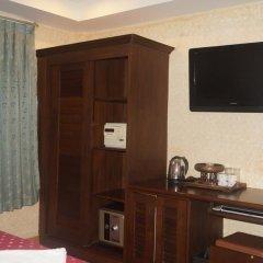 Отель Queen Victoria Inn. удобства в номере фото 2