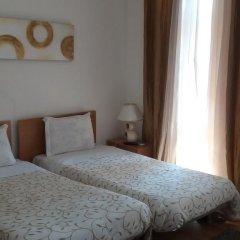 Отель Alojamento Cesarini Португалия, Монтижу - отзывы, цены и фото номеров - забронировать отель Alojamento Cesarini онлайн комната для гостей фото 2
